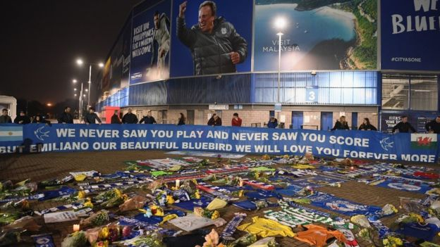 GETTY IMAGES Tributes have been left outside the Cardiff City Stadium