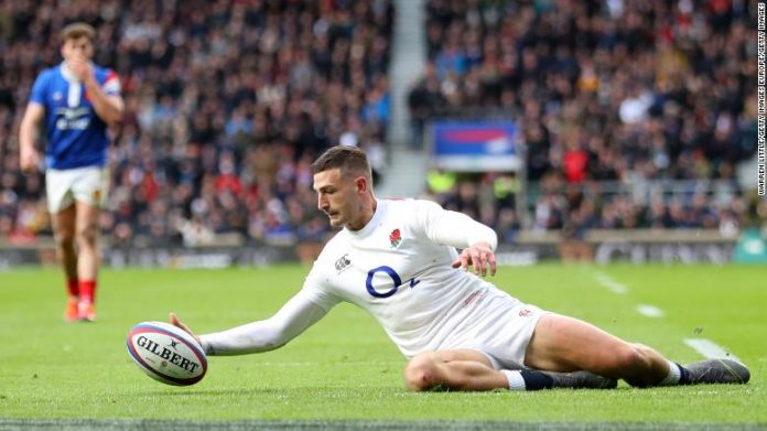 Jonny May touches down for England.