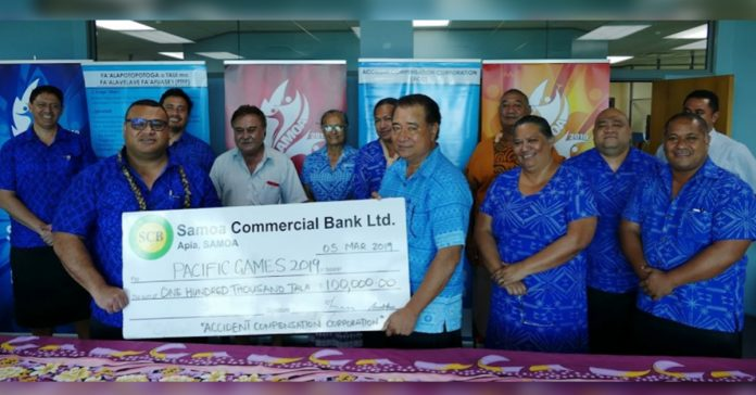 ACC Board Chairman, Leo'o Tautalatasi Dr. John Adams hands $100,000 cheque to Director of Sponsorship, Tagaloa Fouina Su'a.