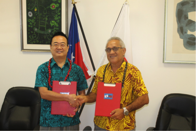 DEAL ACCOMPLISHED: His Excellency Maugaoleatuolo Shinya Aoki and Hon. Tuifa'asisina Misa Risati Leleisi'uao shakes hand after sealing the deal for a project implementation