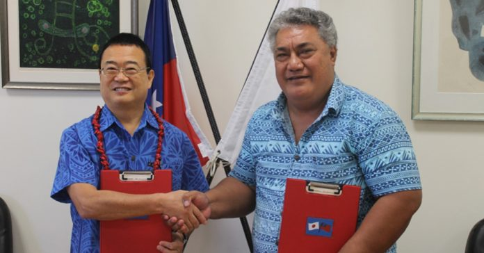 THANK YOU JAPAN: H.E. Maugaoleatuolo Shinya Aoki shakes hand with Tuala Puletini Tuala after the signing of the grant contract.