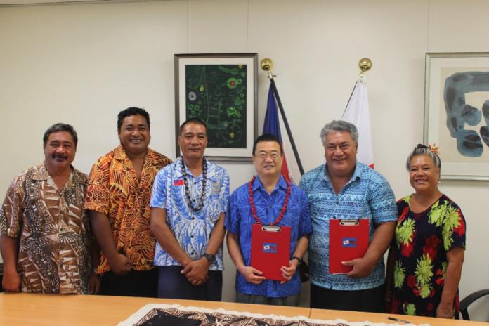 A HELPING HAND: Ambassador of Japan to Samoa, H.E. Maugaoleautolo Shinya Aoki, Chairman of the Leauvaa Primary School committee, Tuala Puletini Tuala with members of the school committee.
