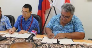 THE SIGNING Ambassador of Japan to Samoa, H.E. Maugaoleatuolo Shinya Aoki and Tuala Puletini Tuala, Chairman of the school committee.OF THE GRANT CONTRACT FOR THE PROJECT FOR THE RECONSTRUCTION OF LEAUVAA PRIMARY SCHOOL