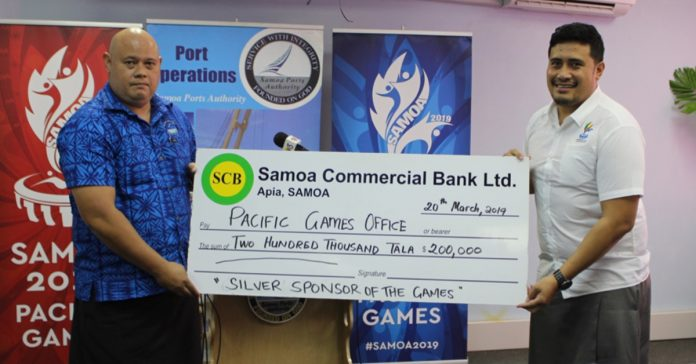 Samoa Ports Authority's Acting Chairman Tuatagaloa presents the cheque to Falefata Hele, CEO of the Pacific Games Office.