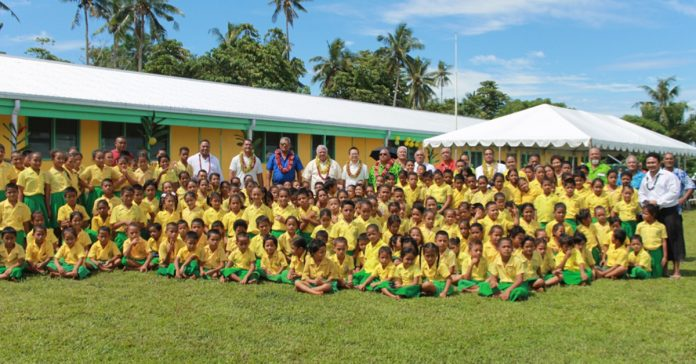 FA'AFETAI LAVA JAPAN: Students happily posing in front of the guests including representatives of two Governments (Japan and Samoa), villagers, parents and teachers as well as their new and improved school building funded under Japan's GGP.
