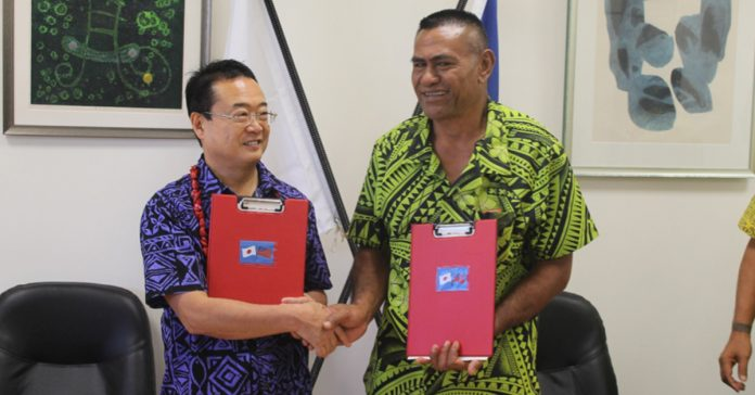SUCCESSFUL RECIPIENT: His Excellency Maugaoleatuolo Shinya Aoki congratulated the President of Papa Sataua Primary School committee Tauatele Taumaia after signing the grant.