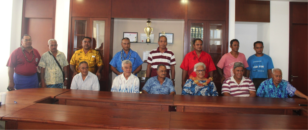 Deputy Prime Minister Fiame Naomi Mataafa (third sitting from right) flanked by members of the Tiavea Village Council at the conclusion of the signing ceremonies this morning.