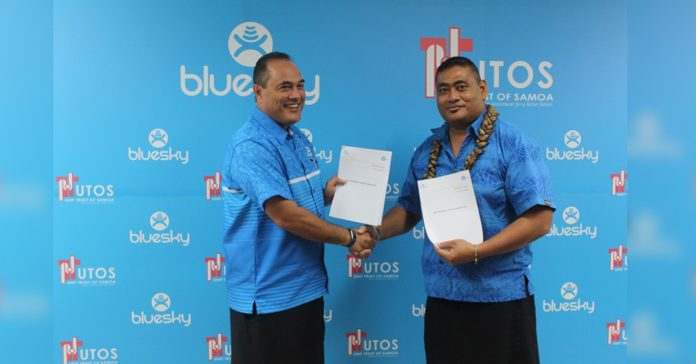 CEO Bluesky Samoa, Toleafoa Douglas Greevey and CEO UTOS, TevagaVianeTagiilima shaking hands and holding signed Agreements for the use of MTALA.