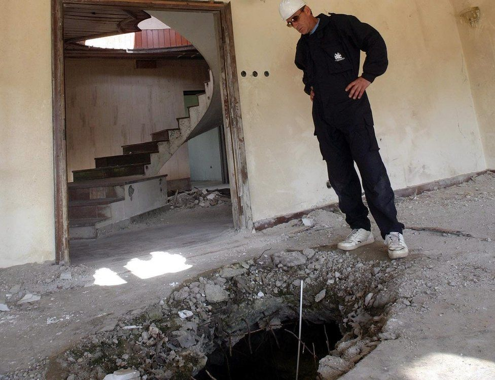 SASA STANKOVIC/EPA Image caption Five bombs hit the embassy compound and one did not explode