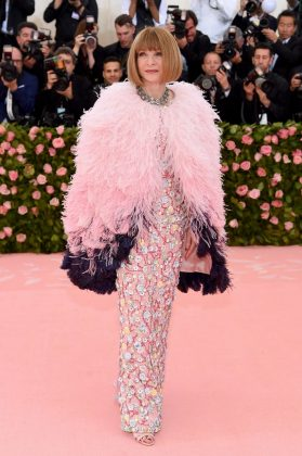 Gala organizer and Vogue's editor-in-chief Anna Wintour kicked off the event in a sequined pink gown and feathered cape by Chanel. Jamie McCarthy/Getty Images