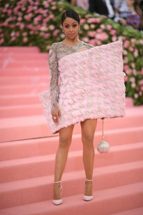 Liza Koshy arrived in a bold feathered pink dress by Balmain.Neilson Barnard/Getty Images