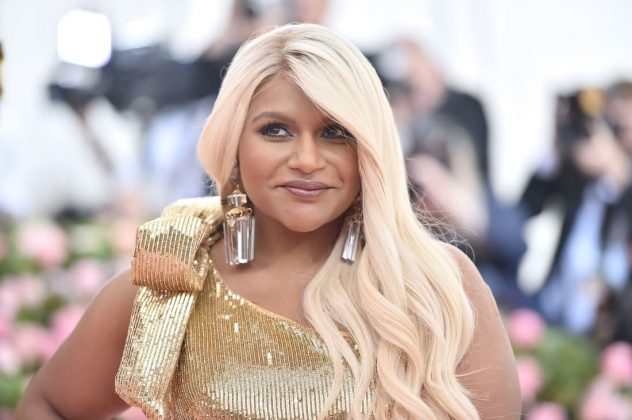 """The Office"" star Mindy Kaling was one of several attendees to wear gold on the red carpet, arriving in a sparkling Moschino dress. She also surprised onlookers with an eye-catching new platinum blonde hairdo. Theo Wargo/WireImage/Getty Images"