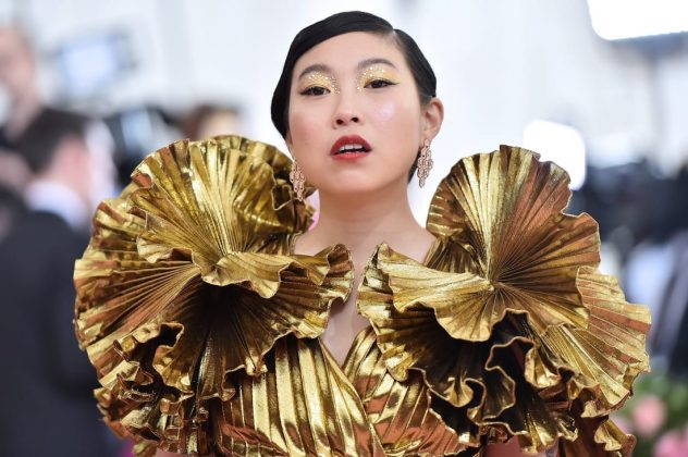 Actress and rapper Awkwafina looked dazzling in a metallic gold Altuzarra dress with exaggerated shoulders. Theo Wargo/WireImage/Getty Images
