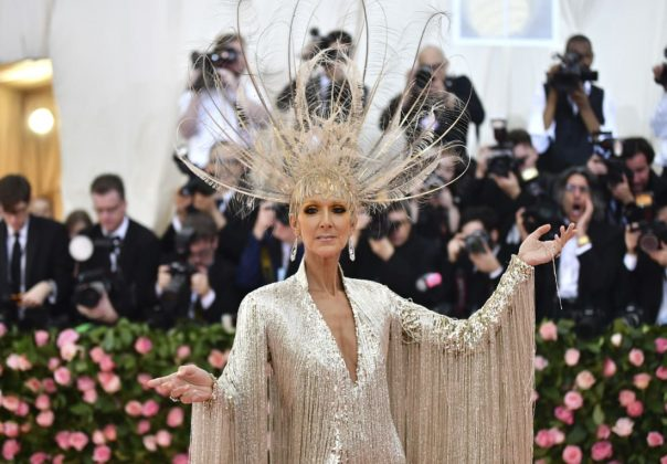 "Celine Dion arrived in an elaborate gown and headpiece by Oscar de la Renta. The label said that it took 52 ""master embroiderers"" over 3,000 hours to hand-bead the 22-pound dress. Charles Sykes/Invision/AP"