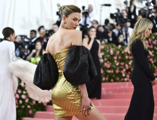 Karlie Kloss glitters in a gold dress designed by Dapper Dan for Gucci at the Met Gala.Charles Sykes/Invision/AP