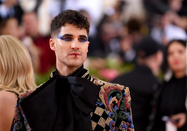 "Darren Criss owned the gala's ""camp"" theme in an embroidered Balmain number, complete with a bow and theatrical blue eye makeup. ""This is one chance I got to go full Duran Duran,"" he told E! during a red carpet interview. Jamie McCarthy/Getty Images"