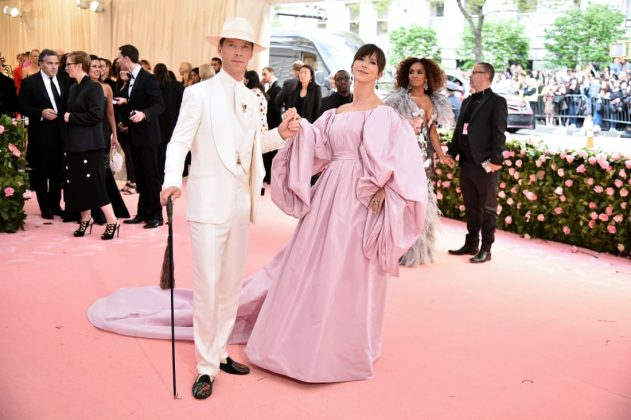 "Benedict Cumberbatch, wearing a Labassa Woolfe suit, and Sophie Hunter embraced the ""camp"" theme in complementary white and pink outfits, respectively.Theo Wargo/WireImage/Getty Images"