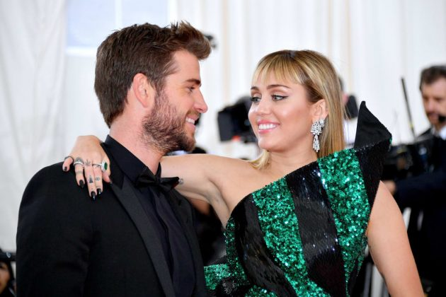 Miley Cyrus arrived in an emerald minidress by Yves Saint Laurent director Anthony Vaccarello, which she paired with Bulgari jewelery. Husband Liam Hemsworth kept things suave and simple in all-black.Dia Dipasupil/FilmMagic/Getty Images