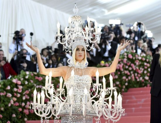 "Whether it's enormous angel wings or a spray-painted dress, Katy Perry always takes the Met Gala theme seriously. And what better motif for her than ""camp,"" a look the singer has embodied on red carpets for more than a decade? Unsurprisingly, Perry went all-out this year, as a life-sized chandelier with electric candles and dripping with crystals, designed by Moschino's Jeremy Scott.Charles Sykes/Invision/AP"