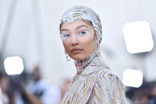 Supermodel Gigi Hadid walked into the Met Gala on the arm of American fashion designer Michael Kors, wearing a metallic form-fitting catsuit with matching feather cape and headpiece. She accessorized with rose-cut diamond earrings by Lorraine Schwartz, contributing to a total of nearly 90 carats of diamonds.Theo Wargo/WireImage/Getty Images