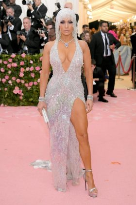 Jennifer Lopez arrived in a Versace gown, complete with a Cleopatra-style headpiece.Neilson Barnard/Getty Images