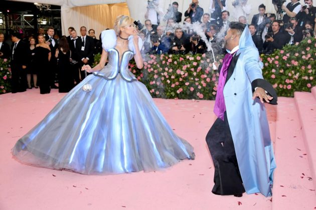Actress Zendaya initially appeared to be wearing a black gown. But as she walked up the stairs, her stylist, Law Roach, waved a wand and transformed her Tommy Hilfiger dress into a glowing version of the iconic baby blue gown worn by Cinderella.Dia Dipasupil/FilmMagic/Getty Images