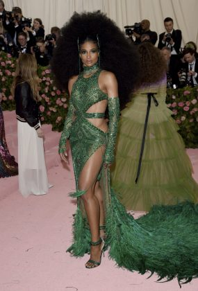 Ciara stunned on the red carpet with a voluminous hairdo and custom emerald gown, complete with ostrich feathered hem, by Dundas. She accessorized with matching belt, gloves and a choker, as well as a House of Malakai headpiece and footwear by Gianvitto Rossi.Evan Agostini/Invision/AP