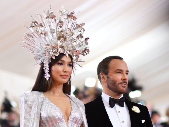 """Crazy Rich Asians"" star Gemma Chan poses with Tom Ford, the designer behind her striking embroidered gown with cape and custom headdress.Angela Weiss/AFP/Getty Images"